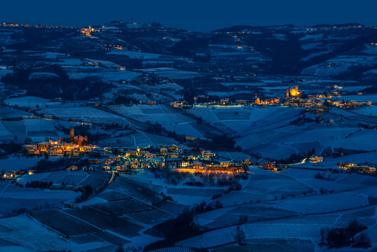 wide angle panorama of Langhe hills in winter, blue hour