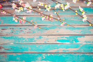 Wall Mural - Cherry blossom flowers on vintage wooden background, border design. vintage color tone - concept flower of spring or summer background