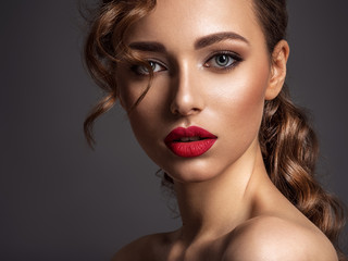 Beautiful face of young woman with red lipstick. Wall mural