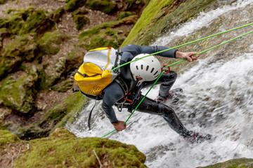 man practicing canyoning