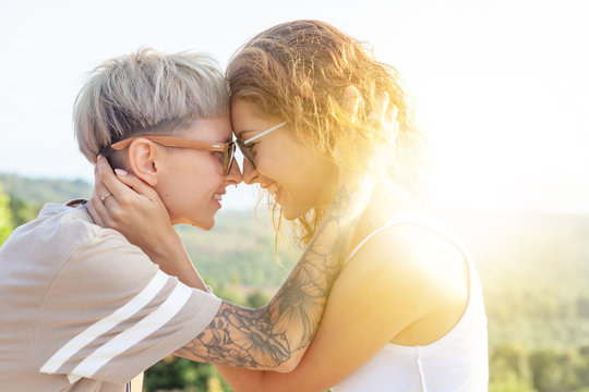 Beautiful lesbian young couple gently lovingly hugging, equal rights for the lgbt community,