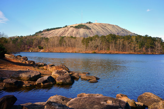 The beautiful blue waters of Stone Mountain Lake with Stone Mountain Summit. Natural beauty of Stone Mountain Park in Georgia, USA.
