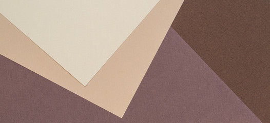 Color papers geometry composition banner background with beige and brown color tones