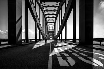 Girl walking on bridge