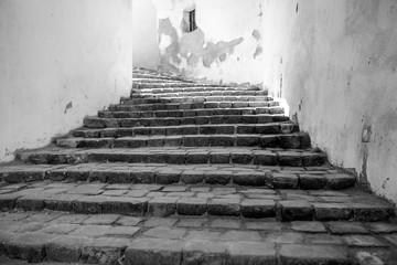 Medieval staircase in Sighisoara, Transylvania Romania in black and white.