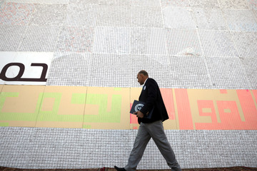 An official from Guinness World Records checks the largest sign with wishes for Mother's Day, in Amman