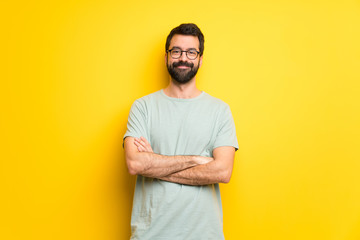 Man with beard and green shirt with glasses and happy Wall mural