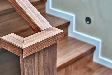 Part of wooden steps with glass railings. Walnut staircase Wall mural