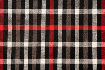 Tartan plaid natural cotton fabric. Seamless tiles texture for the background
