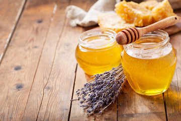 jar of lavender honey with honeycombs