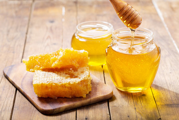 jar of honey with honeycombs
