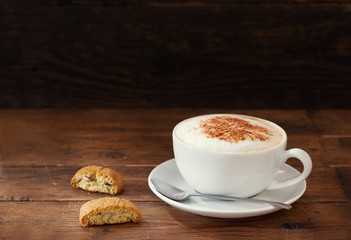 cup of cappuccino coffee with cookies