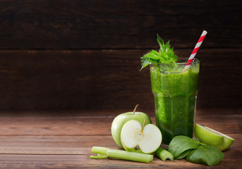 glass of green juice smoothie with spinach, apple and celery