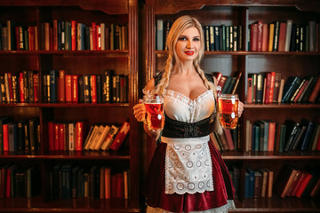 Octoberfest waitress with mugs of beer in pub