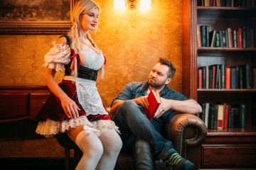 Man and sexy waitress in traditional retro style