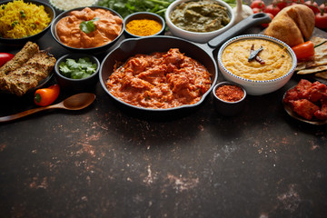 Assortment of various kinds of Indian cousine on dark rusty table Fototapete