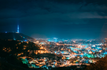 Tbilisi, Georgia. Top View Of Cityscape Skyline City In Night Illuminations. Georgian Capital