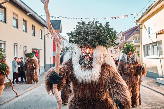 Haired wild man is looking into the camera. Carnival party in southern Germany - Black Forest.