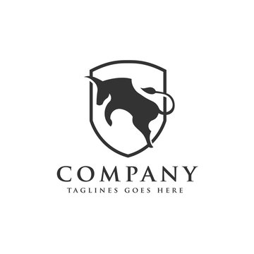 bull jump or angry bull with shield logo vector concept