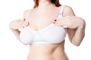 Breast test, woman examining her breasts for cancer, big natural boobs isolated on white background
