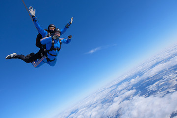 Tandem skydiving. Two guys are having fun in the sky.