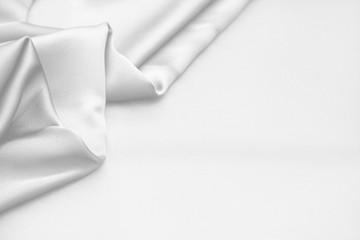 Rippled white silk fabric satin cloth waves background