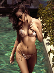 Sensual young lady realxing in a hot tropical water