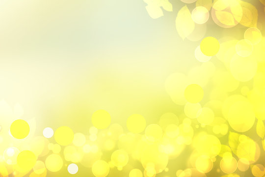 Sunny abstract bright yellow green bokeh autumn background texture with leaves. Space for your design. Beautiful yellow illustration.