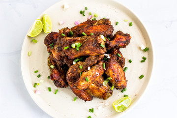 Spicy Jamaican Jerk Chicken Wings with Lemon Wedges, Top View Photo. Popular Caribbean Chicken Preparation, Chicken Appetizer..