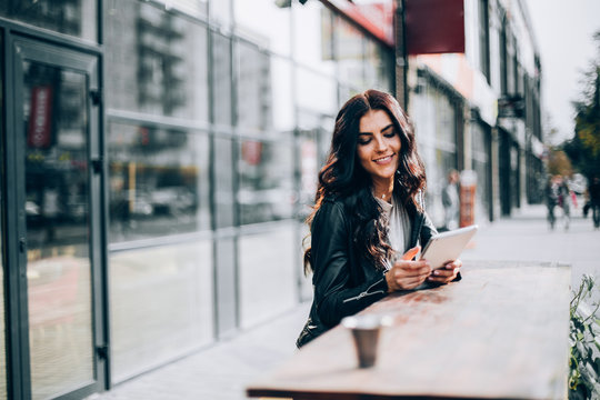 Young pretty spanish woman in cafe in city centre
