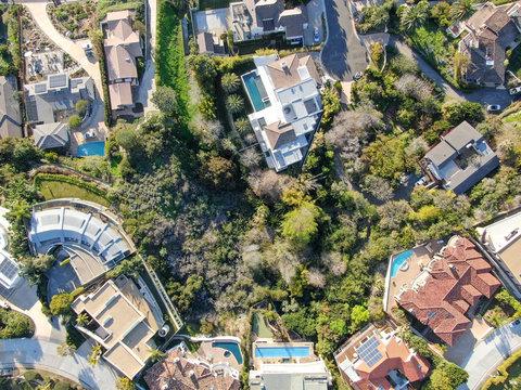 Aerial view of La Jolla little coastline city with nice beautiful wealthy villas with swimming pool. La Jolla, San Diego, California, USA.  West coast real estate development.