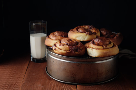 Freshly baked cinnamon buns with spices and cocoa filling. Sweet Homemade Pastry, dessert.