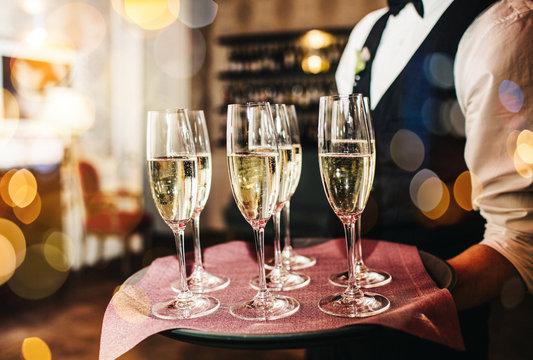 Champagne glasses on sparkling background.