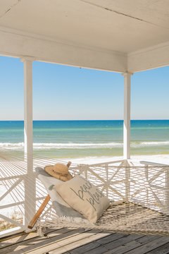 Hammock and Beach Hat on Porch with View of Ocean