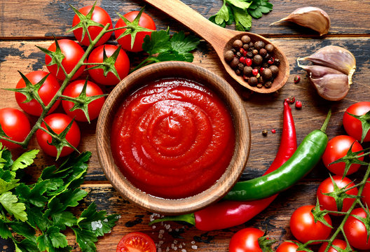 Fresh homemade ketchup with ingredients for making.Top view with copy space.
