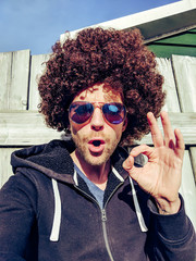 Man with afro hair having funny face