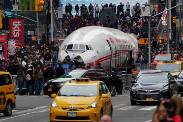 The fuselage of a TWA plane is pictured parked in Times Square before being brought to JFK airport to be used as a cocktail lounge in New York