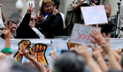 Hebe de Bonafini, member of the human rights organization Madres de Plaza de Mayo waves to supporters at the march towards Plaza de Mayo square to commemorate the 43rd anniversary of the 1976 military coup, in Buenos Aires