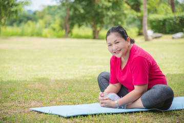Portrait of asian aged women doing yoga exercise in park