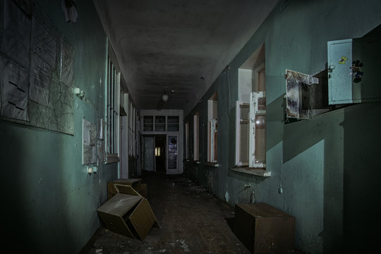 Dark creepy corridor of abandoned building