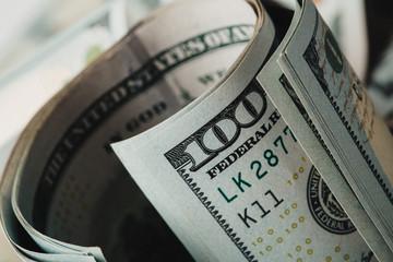 American dollars. A stack of hundred dollar bills. Close up