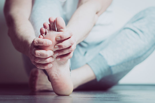 man with pain in foot