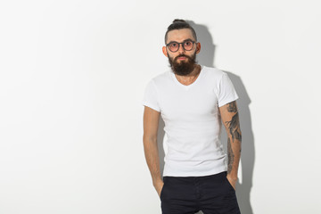 hipster, people concept - Tattooed bearded man in white shirt isolated on white background
