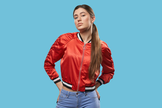 Youth style. Portrait of model in bright red bomber.