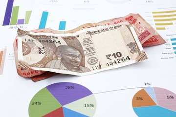 Portrait of Indian currency on the financial paper.