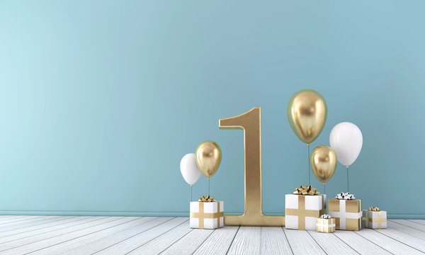 Number 1 party celebration room with gold and white balloons and gift boxes.