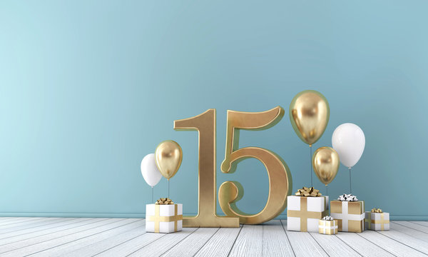Number 15 party celebration room with gold and white balloons and gift boxes.