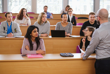 Lecturer and multinational group of students in an auditorium