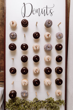wedding chocolate donuts for guests. festive concept. sweets on a wedding day. wedding donuts
