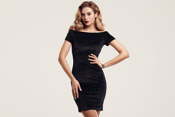 Gorgeous elegant sensual blonde woman wearing fashion black dress